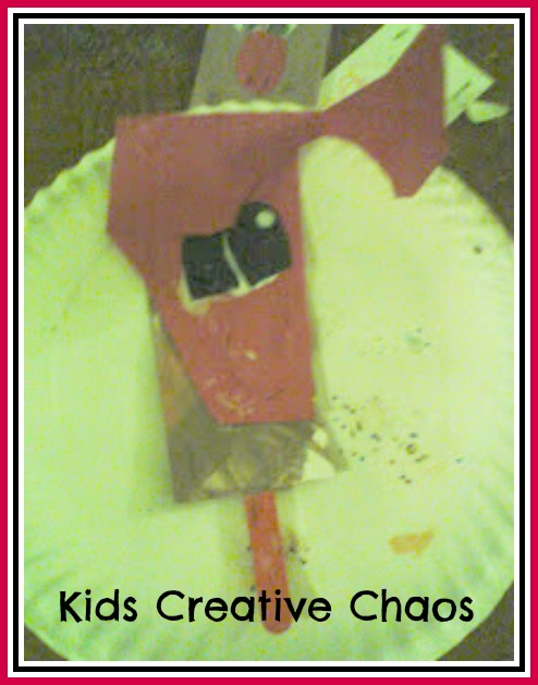 Reindeer paper and popsicle stick craft for toddlers.