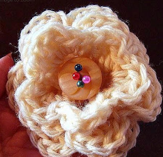 http://www.craftsy.com/pattern/crocheting/accessory/yt-3-layer-crochet-flower/53783
