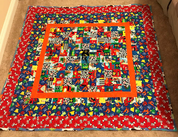 Boy quilt with animals, monsters, soccer balls, trains and cars