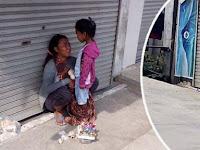 Tak Mampu Beli Nasi Karena Dagangan Tak Laku, Ibu Penjual Parfum ini Hanya Bisa Berbagi Roti Dengan Anaknya