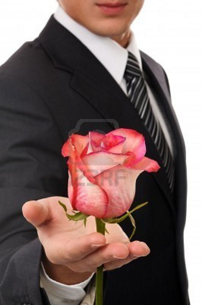 8040541-young-business-man-hold-rose-isolated-on-white.jpg