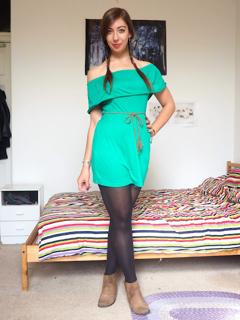 Peter Pan inspired Disneybound outfit of green off-the-shoulder dress, black tights, brown belt & ankle boots