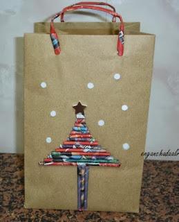 http://enganchadaalreciclaje.blogspot.com.es/2013/12/bolsa-de-papel-para-regalo.html