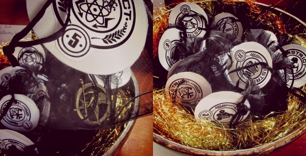 Favors: Mockingjay pendants with printable district tags