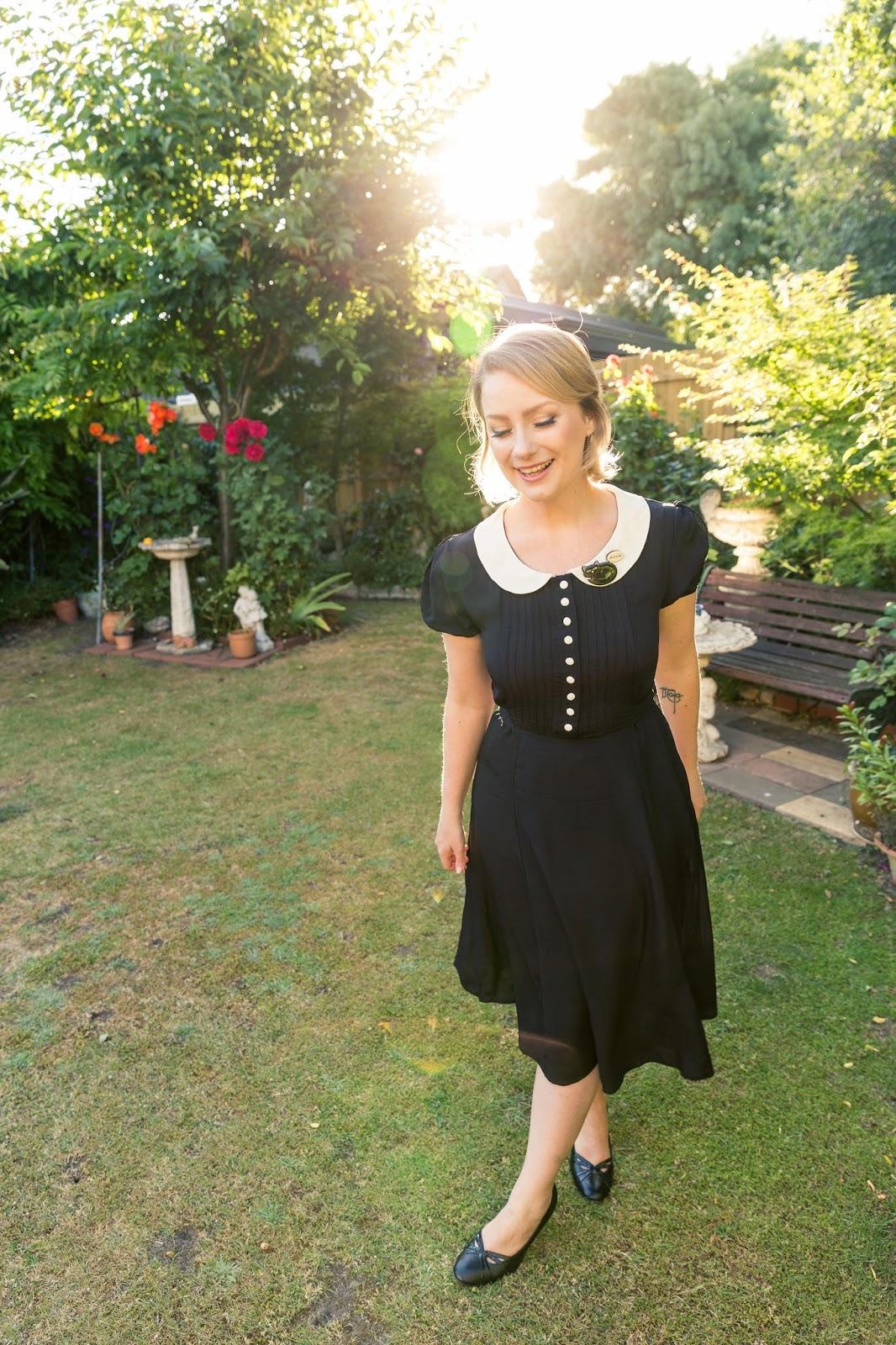 @findingfemme wears Seamstress of Bloomsbury black dress and Bok Bok B'Gerk cat brooch.