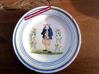 Unique old Malicorne pottery made in France. late 1800s faience plates depicting breton Man and floral pattern related to Pouplard Beatrix model.