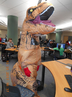 image of student in t-rex costume