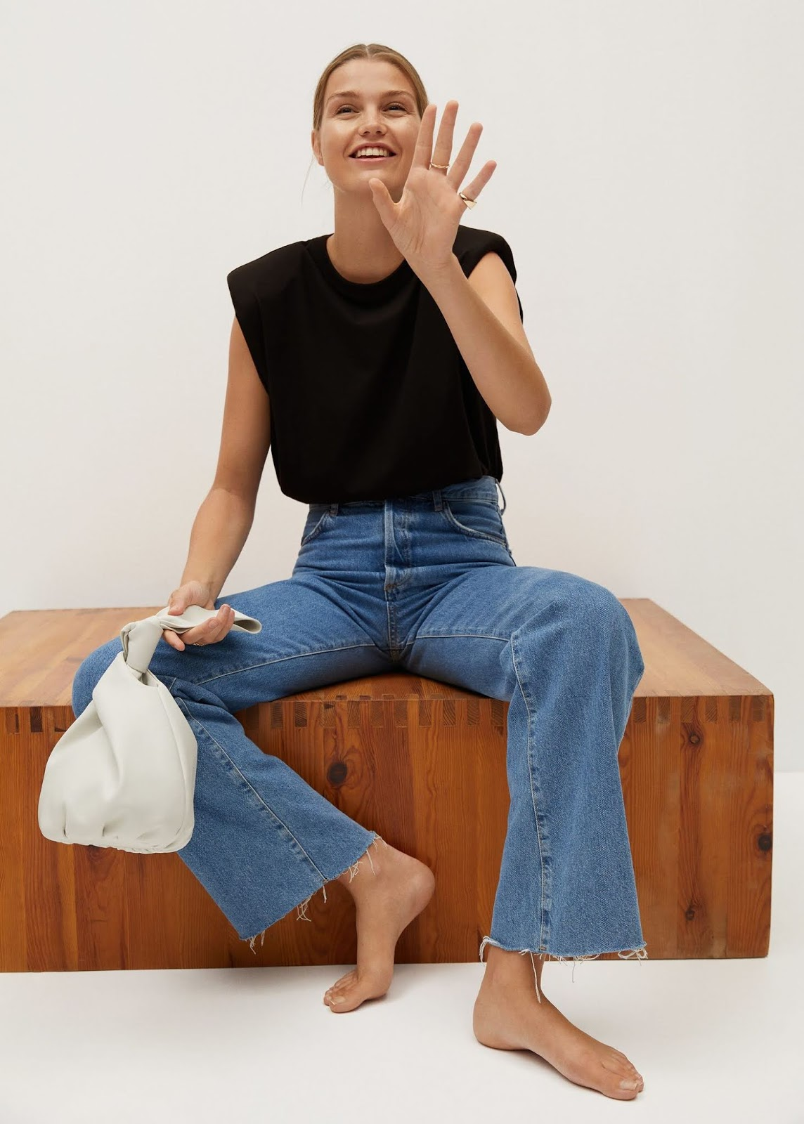 How to Wear a Padded-Shoulder Tank Top — White Mini Bag and Raw-Hem Jeans