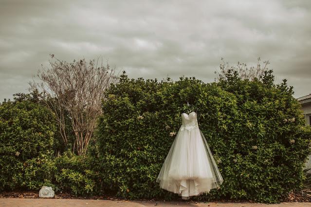 Wedding dress displayed outside of Bella Ranch