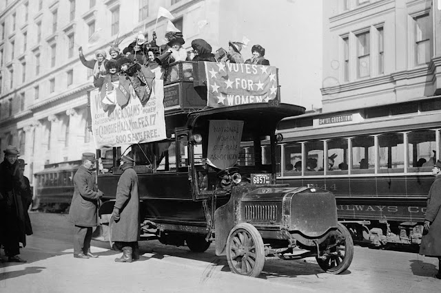 Suffragists on bus in New York City, part of the suffrage hike to Washington, District of Columbia, which joined the March 3, 1913 National American Woman Suffrage Association parade.