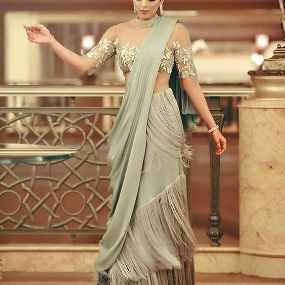 dc95d554f314 A heavy blouse to show off works just right for this style of saree draping.