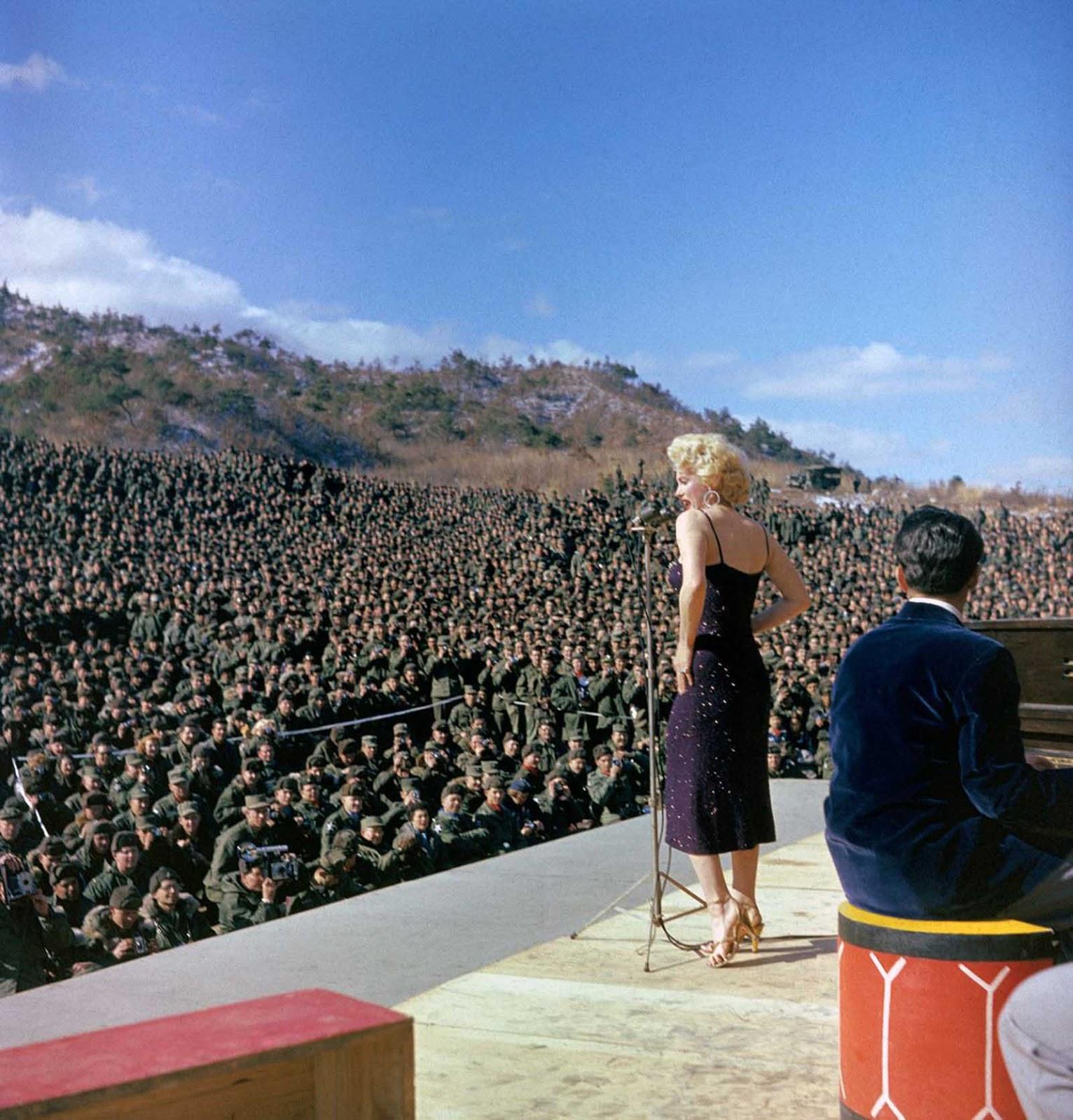 Marilyn Monroe onstage entertaining the troops.