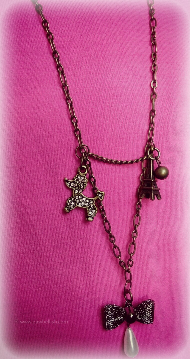 The perfect charm necklace for dog lovers with a 36 inch chain and Poodle Paris themed charms