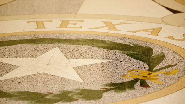 Texas and Lone Star in the floor at the Capitol in Austin