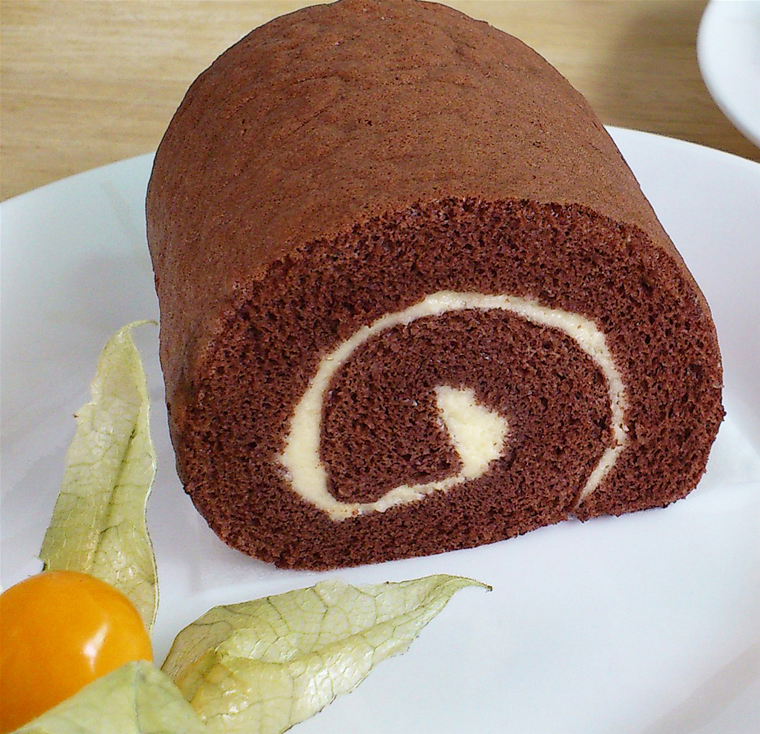 1 piece of chocolate swiss roll, decorated with golden berry