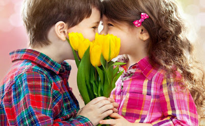 Baby Boy and Girl with Flower