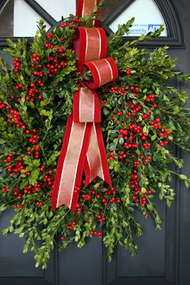 Beautiful boxwood and berries wreath from Sweet Something Designs | Friday Christmas Favorites at www.andersonandgrant.com