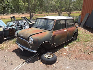 For sale classic Mini-Cooper rusty needs new floor .offers