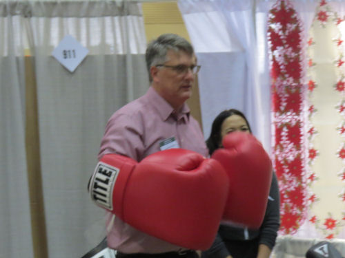 man wearing huge boxing gloves