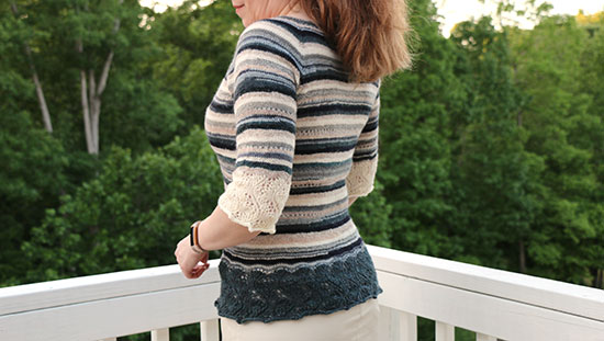 Back view of Elphaba Pullover knit in stripes of scrap sock yarn.