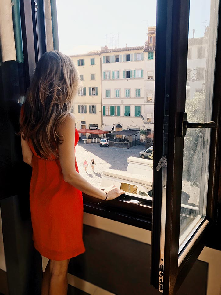 Looking out the window of an apartment in Piazza Santo Spirito in Florence Italy