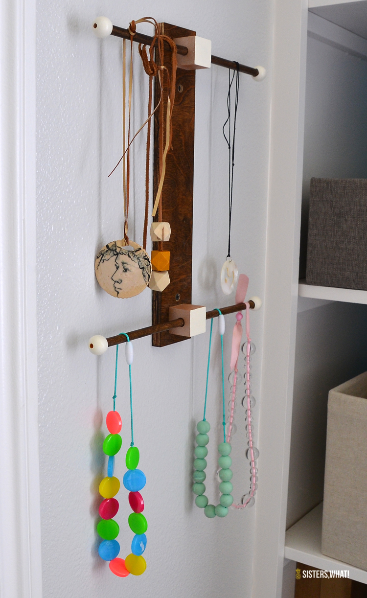 a minimalist jewelry marie kondo style wood  necklace hanger