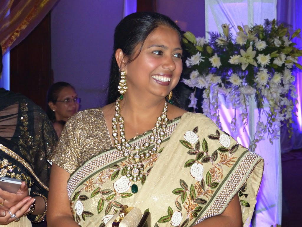 Indian woman wearing sari and traditional set of a necklace and earrings
