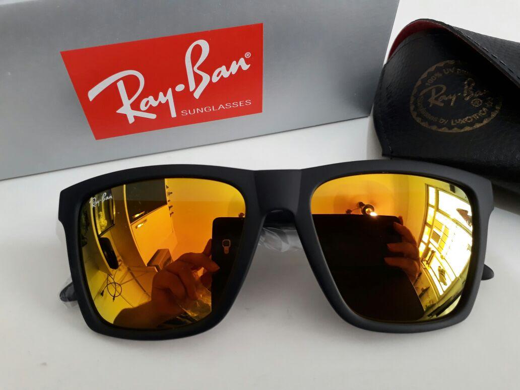 8238dcb5a óculos réplica ray-ban masculino e feminino . Masculino, armação preta com  lente espelhada laranja. acompanha a case e flanela de brinde.