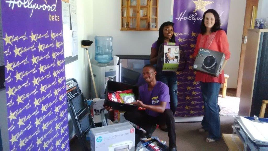 CANSA Waterberg staff members are thankful for a donation of office equipment from Hollywoodbets