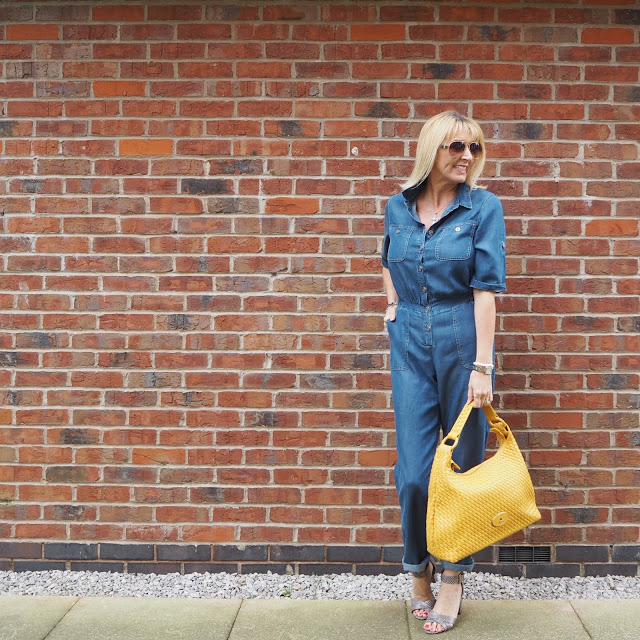 denim jumpsuit and mustard bag