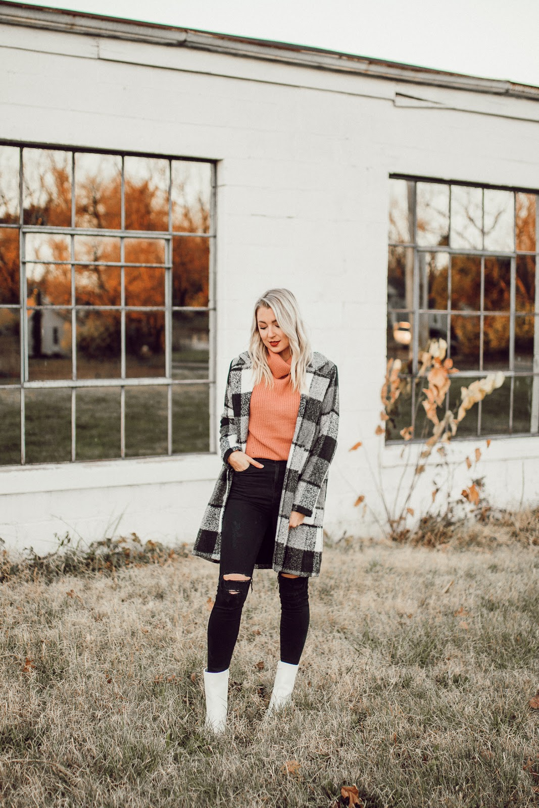 cute plaid coat over a pink sweater