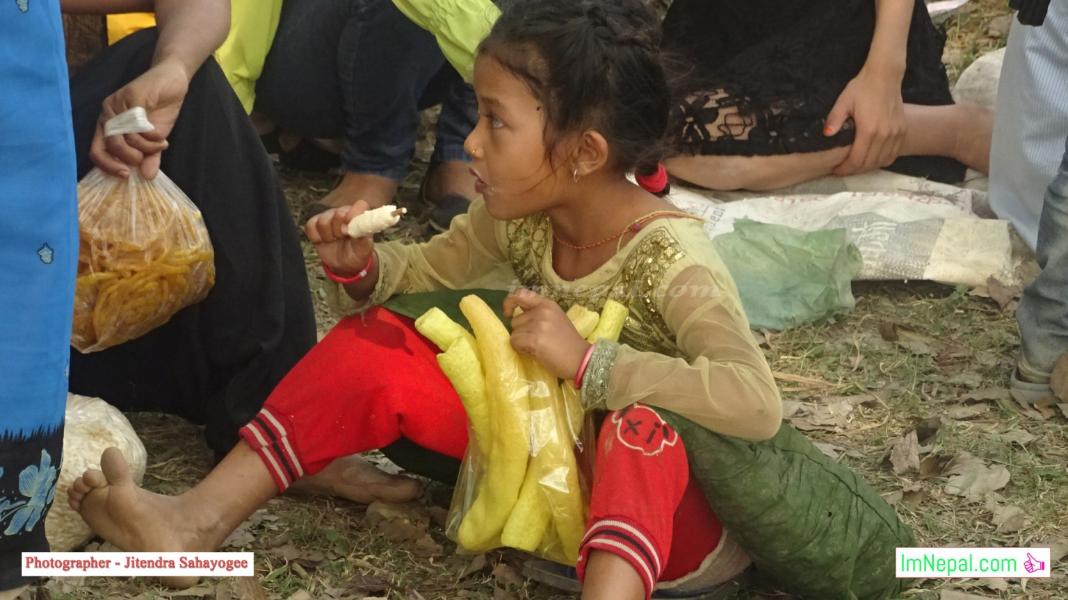Pictures of Little Girl in Nepal is Eating Ice Cream