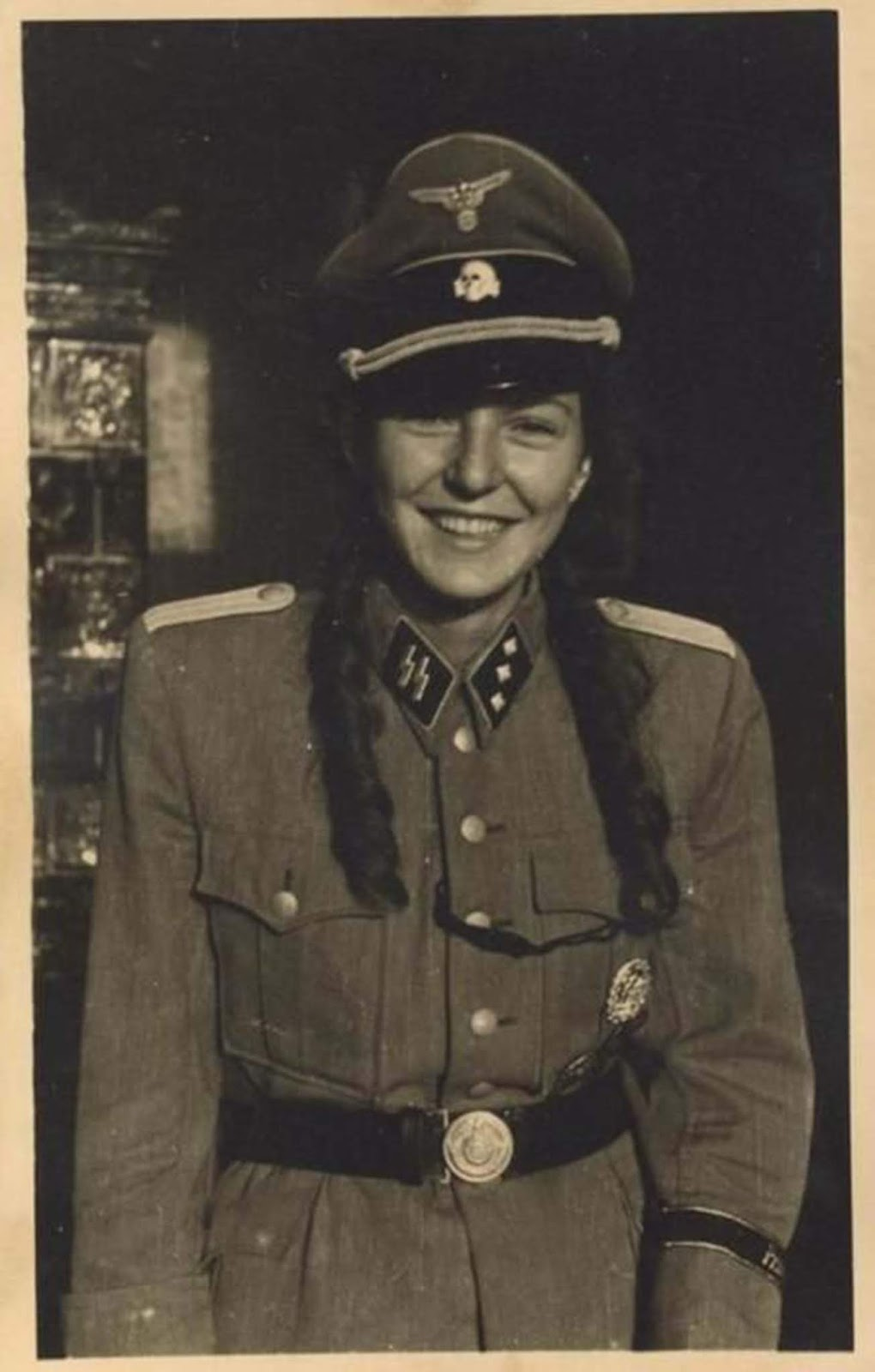 A French girl wearing y she's wearing what appears to be a very authentic SS uniform. Read more on this article: Sleeping with the enemy: Collaborator girls of the German-occupied Europe.