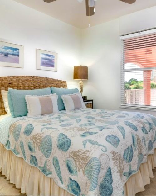Coastal Seashell Quilt Bedding in Condo Bedroom