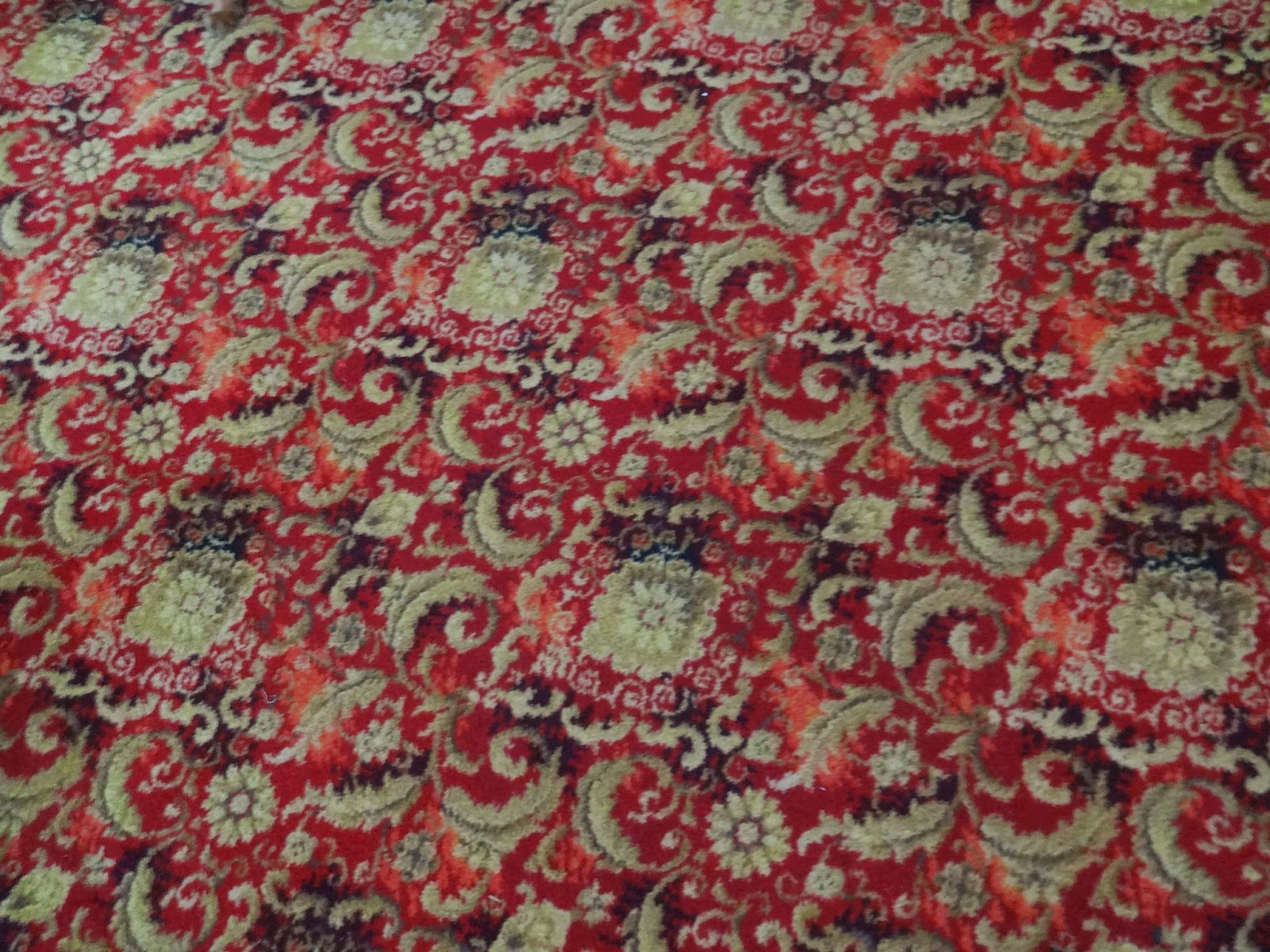 retro red swirled carpet