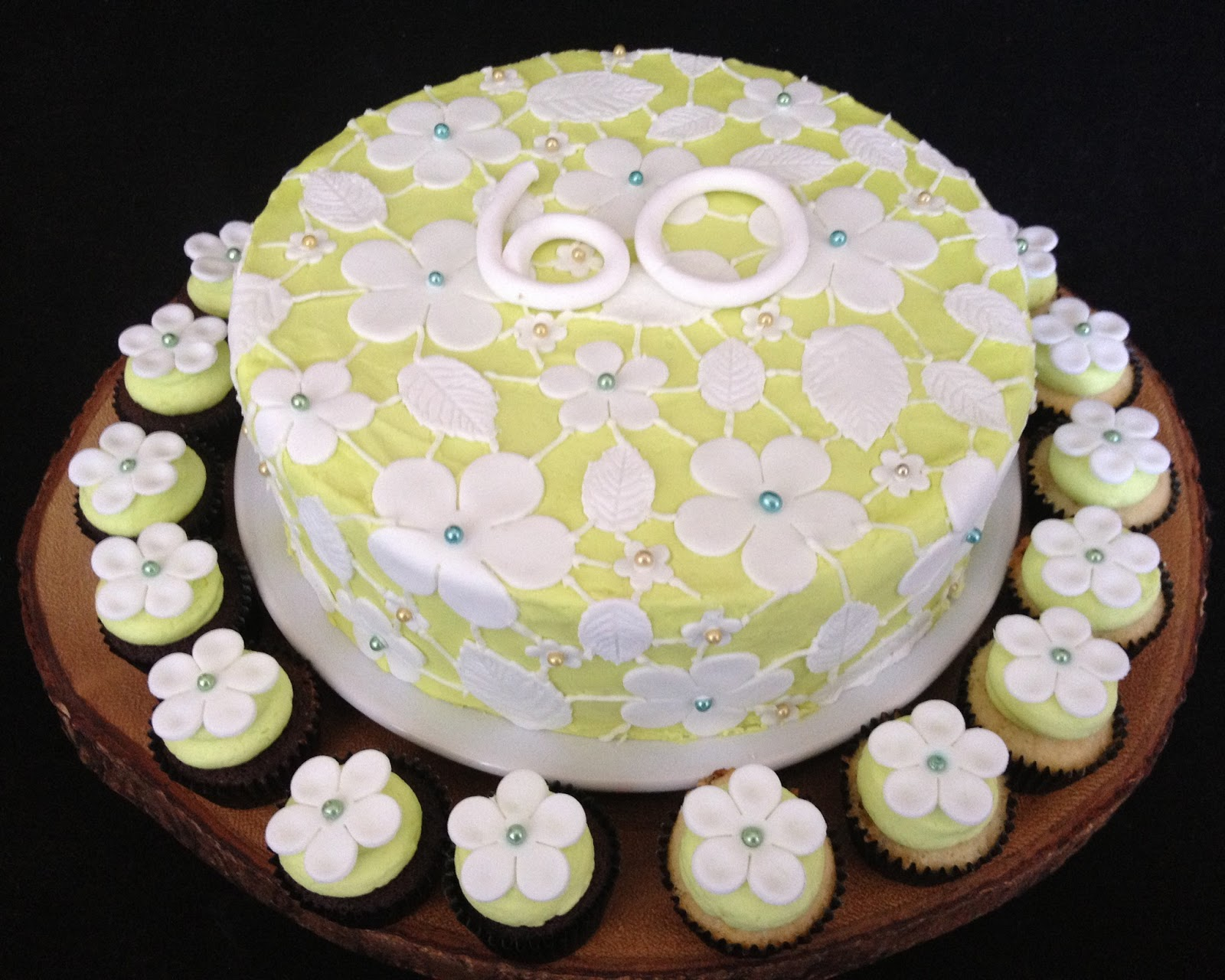 The Cake Was Iced In A Pale Green Then Covered Flowers And Leaves Cut Out Of White Fondant I Joined Them All With Some Royal Icing To Make It Look