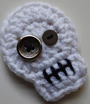 http://www.ravelry.com/patterns/library/spooktacular-sugar-skull-applique