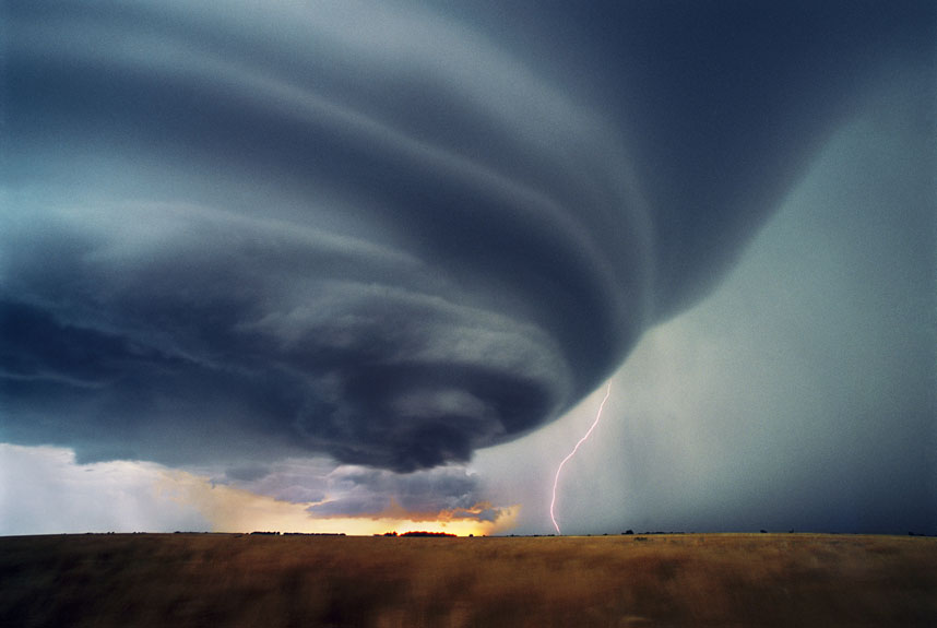Lightning strikes the ground from a supercell thunderstorm. Supercell thunderstorms
