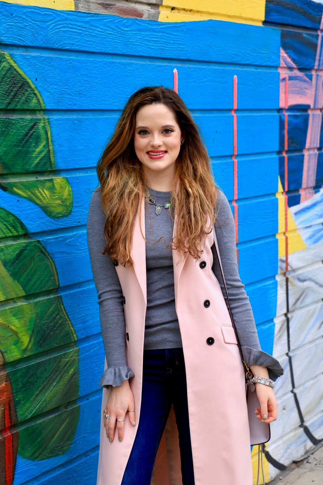 pink sleeveless trench coat