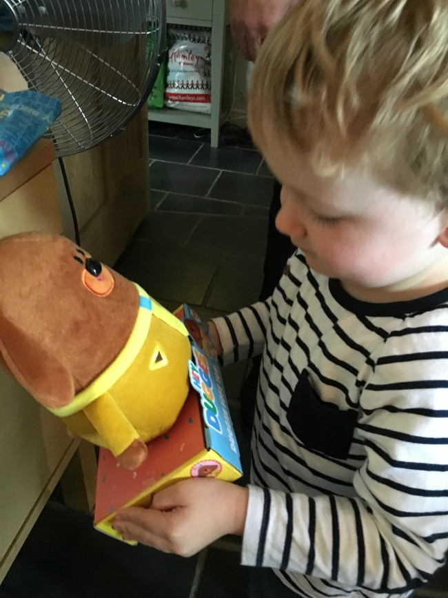 toddler-looking-at-soft-toy-hey-duggee