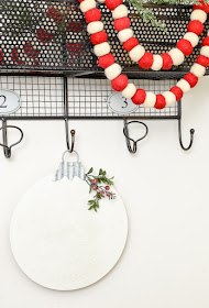 Add a bit of holiday cheer to your walls with this inexpensive wood ornament decor from Dollar Tree.