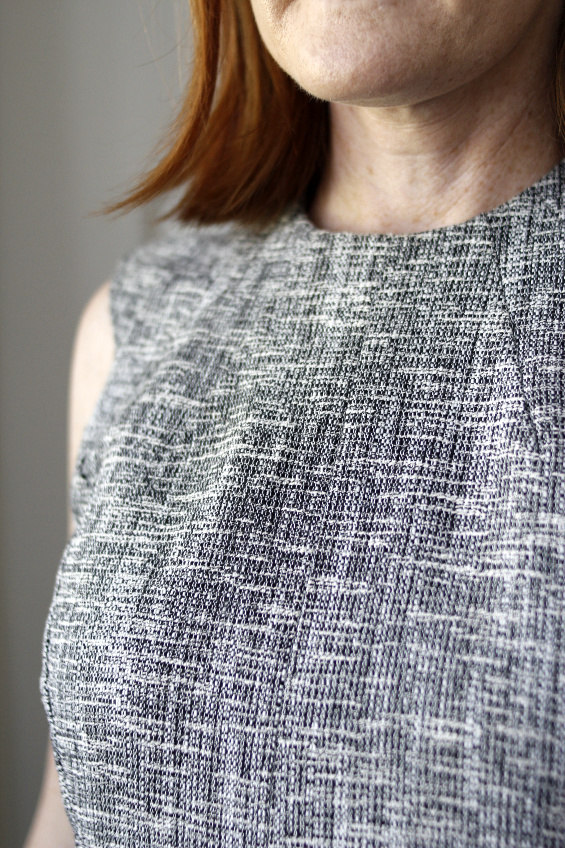 close up photo of the neckline of a grey dress