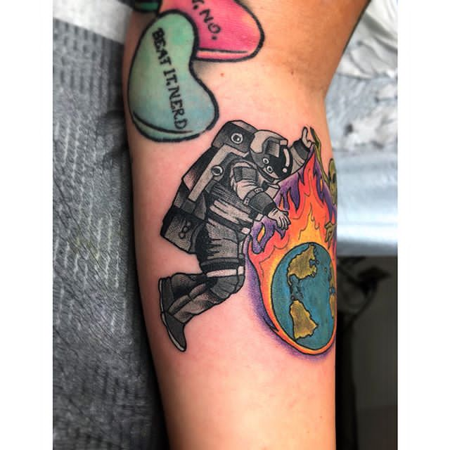 astronaut and earth tattoo