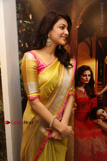Actress Kajal Agarwal Stills in Golden Silk Saree at Trisha Sesigner Store Launch  0059.jpg