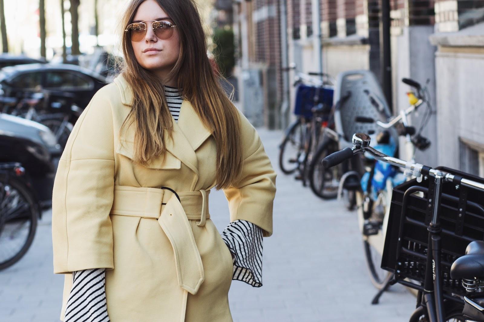 blogger Dominique Candido deau wearing a mango coat prada sunglasses balenciaga boots j brand jeans and a chanel bag