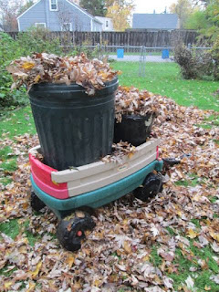 Little tike wagon full of leaves