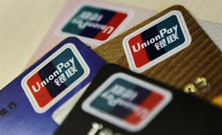 Logos of China UnionPay are seen on bank cards in this photo.
