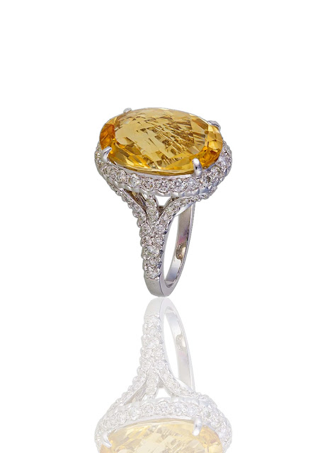 A marvelous oval shaped 11.42 ct               citrine ring, handcrafted in 18 kt white gold from  MIRARI.