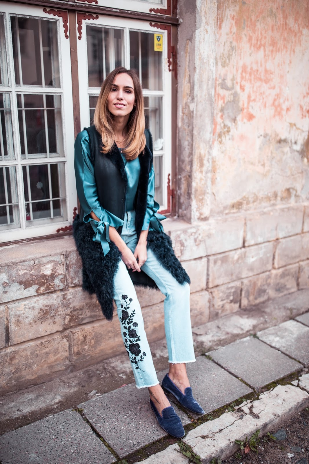 silk shirt shearling gilet jeans outfit