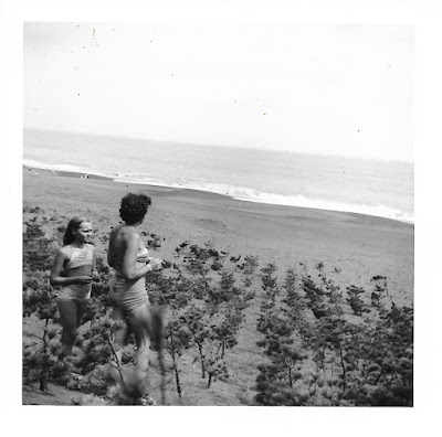 Natalie Vasilev and her daughter Tatiana (aka Tanya Sarsfield) hang out on the beach near Kamakura, Japan in 1951.